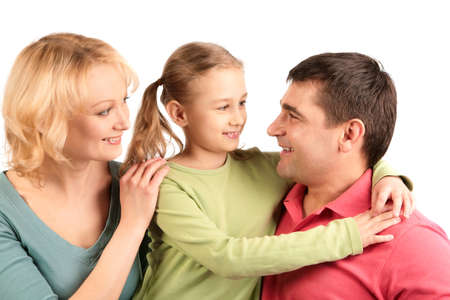 Portrait of happy parents and their daughter smiling Stock Photo - 8525128