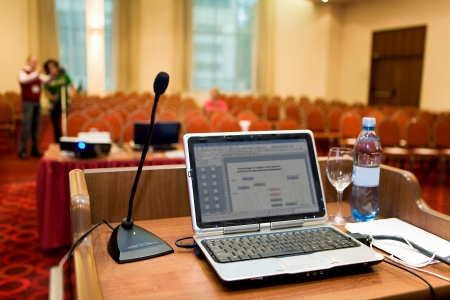 briefing: Image of laptop on workplace of lecturer Stock Photo