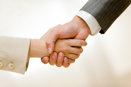 Photo of handshake of business partners after signing contract Stock Photo - 8522810