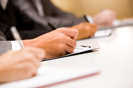 business report: Image of human hands making notes or writing business plan Stock Photo