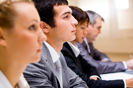 Image of businessman among his colleagues at conference  photo