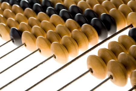 Close-up of wooden abacus used for counting photo