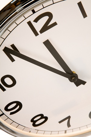 Clock showing five minutes to twelve photo