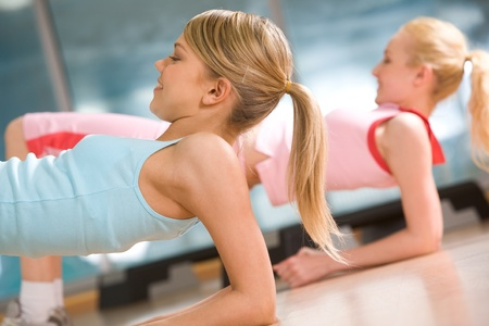 Image of sporty girl doing physical exercise on elbows Stock Photo - 8523917