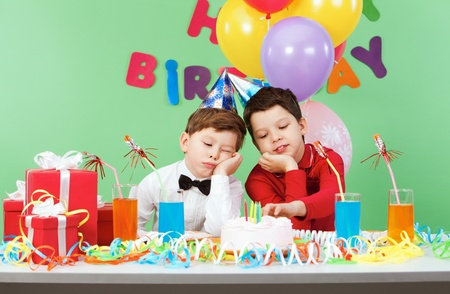 boring: Portrait of two boys boring during birthday party