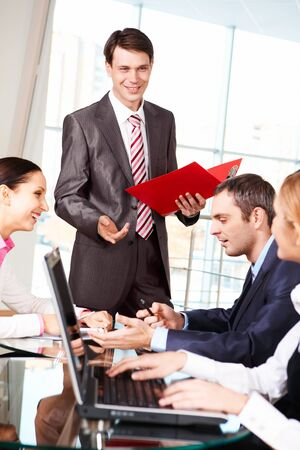 Image of business group discussing new project or plan in the office  photo