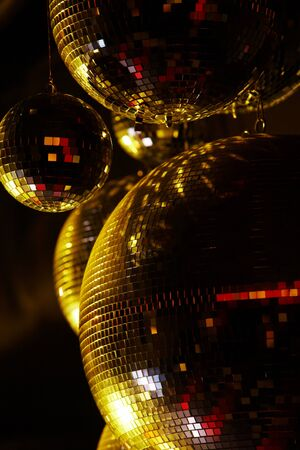 large ball: Vertical image of disco balls sparkling in darkness