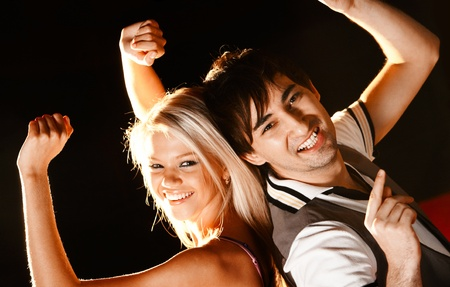 Positive couple looking at camera with smiles during disco Stock Photo - 8528107