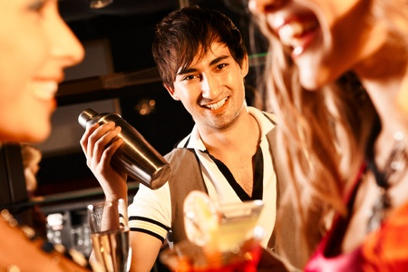 Portrait of smiling male with bottle looking at camera in the bar photo