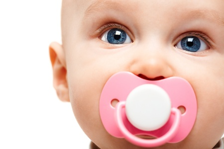 daycare: Face of adorable baby with pacifier in mouth looking at camera