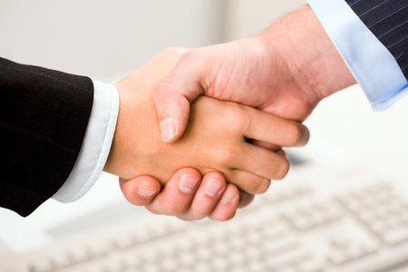 handshake of business partners after signing promising contract Stock Photo - 8527354