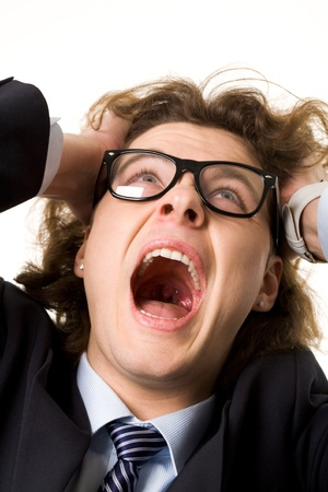 Portrait of frustrated businessman screaming while keeping his hands on head Stock Photo - 8529098