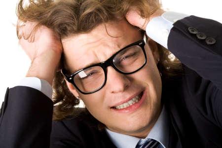 Stressed businessman in eyeglasses on white background photo