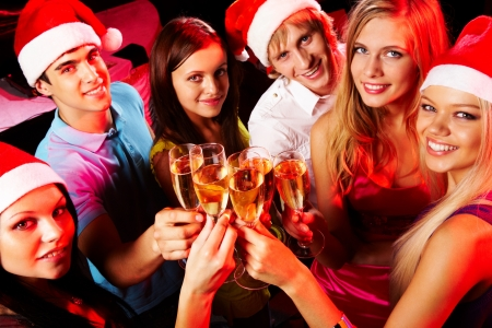 girl party: Above angle of young people enjoying themselves at Christmas party
