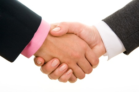 joined hands: Handshake of business partners after signing promising contract  Stock Photo
