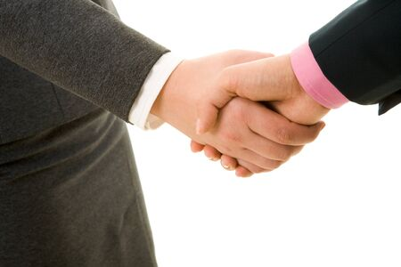Handshake of business partners after signing promising contract  photo