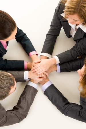 Image of business people keeping hands on top of each other at workplace Stock Photo - 8528121