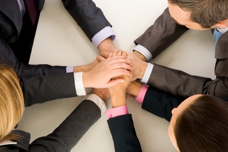 Image of business people keeping hands on top of each other at workplace Stock Photo - 8529157
