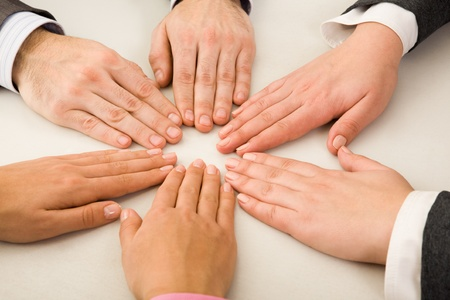 altogether: Image of business partners hands making circle on table Stock Photo