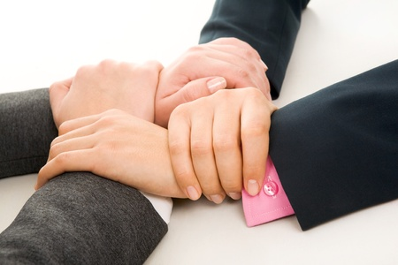 linked together: Image of crossed hands of business partners  Stock Photo