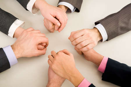 business protection: Image of business partners hands holding each other Stock Photo