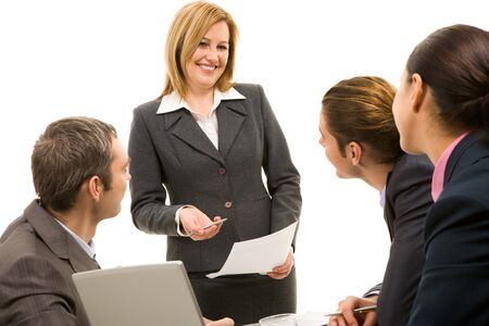 Image of businesswoman making report at working meeting photo