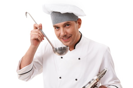 Portrait of handsome man in uniform looking at camera while tasting food photo