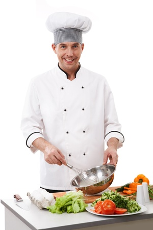 preparing: Portrait of handsome man in cook uniform smiling at camera during work