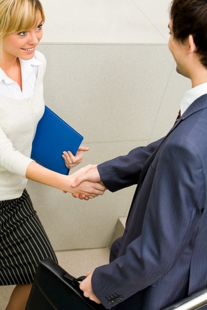 Partners handshaking after signing contract photo