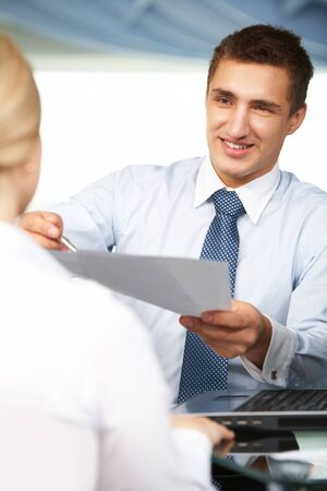 brokers: Handsome employer giving contract to his partner to sign Stock Photo