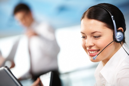 head support: Portrait of executive female in headset smiling during communication