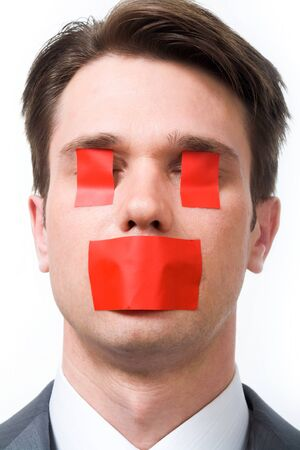 Businessman with red stickers on his eyes and mouth Stock Photo - 8531062