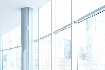 office background: Image of big windows passing daylight inside office building