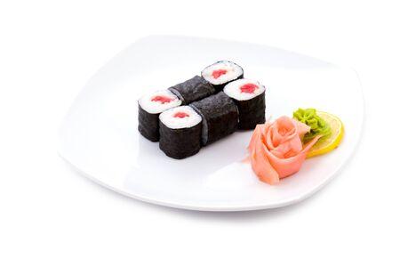 tekka: Image of tekka hosomaki sushi with pickled ginger and wasabi on a plate Stock Photo