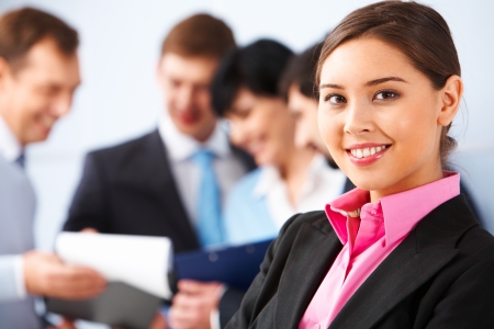 competitive business: Photo of pretty business leader looking at camera in working environment