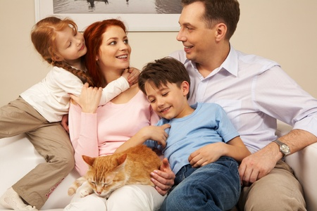 Portrait of affectionate parents and their children enjoying weekend day at home photo