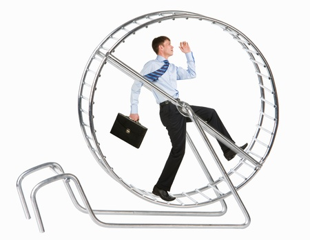 Photo of running man in metal wheel over white background photo