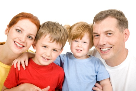 Portrait of cheerful parents with their two children on a white background Stock Photo - 9115210