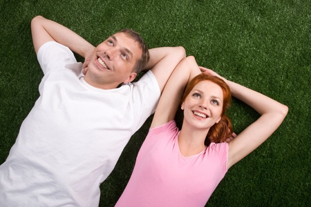 Photo of handsome man and his wife lying together Stock Photo - 9106209