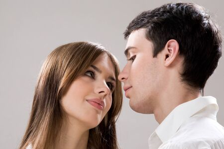 Photo of pretty girl and handsome guy looking at each other with admiration Stock Photo - 9109296