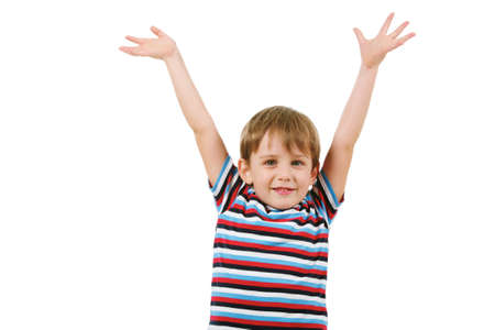 Portrait of joyful boy looking at camera with raised arms