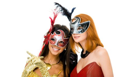 Portrait of glamorous girls looking through venetian masks during carnival photo