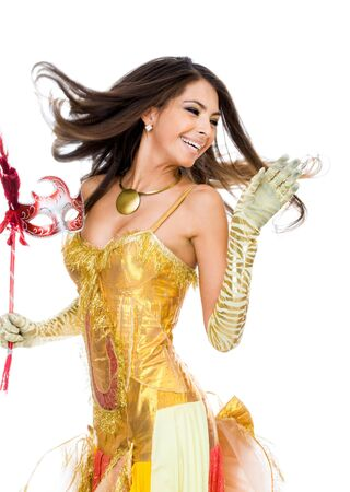 masks: Portrait of playful woman in glamorous attire and mask in hand