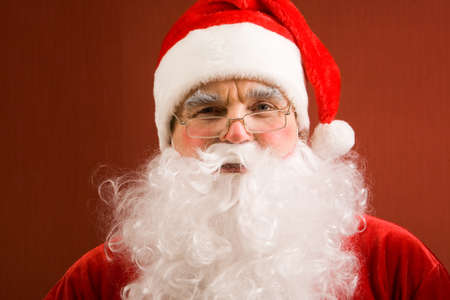 Photo of happy Santa Claus in eyeglasses looking at camera Stock Photo - 9455140