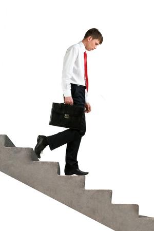 Image of sad businessman walking downstairs photo