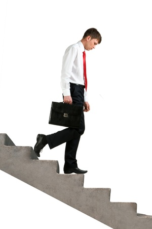 walking down: Image of sad businessman walking downstairs