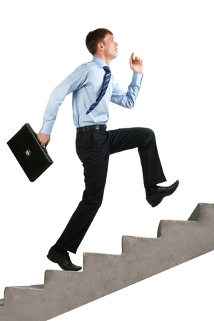 steps to success: Image of happy businessman running upstairs Stock Photo