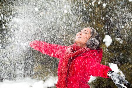 winterwear: Portrait of beautiful woman taking pleasure on snowy winter day  Stock Photo