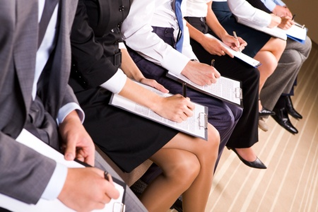Photo of row of business people making notes or writing business plan Stock Photo - 9164319