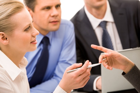 Photo of business lady looking at co-worker and listening to explanation with attention photo